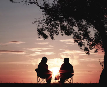 Two people enjoying a sunset
