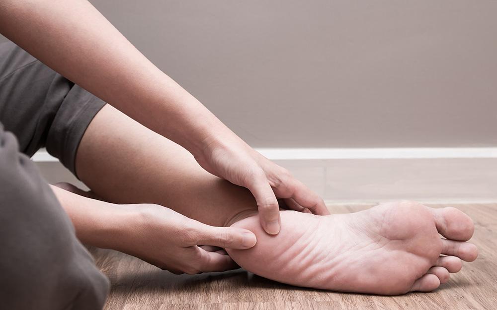 pushing on heel of foot